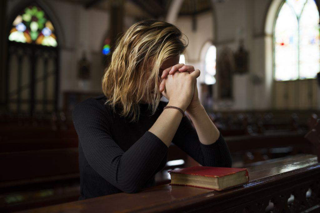 Woman Sitting In Church